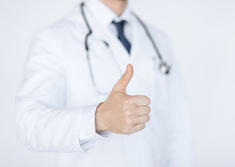 male doctor hand showing thumbs up