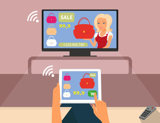 Multiscreen interaction. Woman is purchasing red bag online in