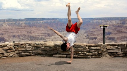 Tourist dancing breakdance in Grand Canyon National Park usa