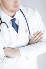 doctor with stethoscope in white uniform