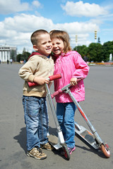 Happy children with scooter