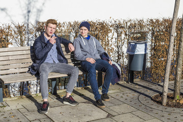 cool boys sitting on a bench