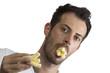Man eating puffs