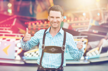 Man in Bavarian Lederhosen doing thumbs up