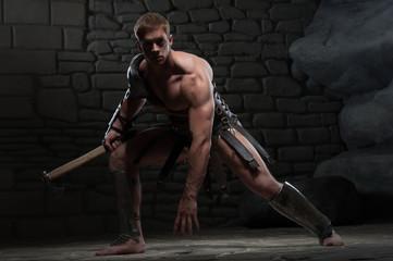 Gladiator with axe kneeling