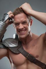 Gladiator despair on grey background