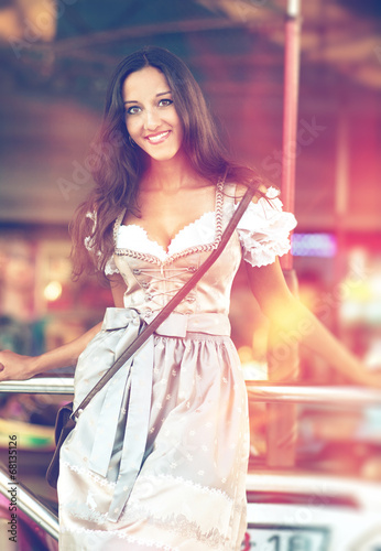 German Woman posing and wearing traditional Dirndl