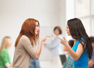 two teenagers having a fight at school