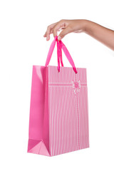 Woman hand holding gift bag