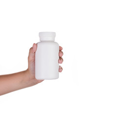 Hand holding upplements or  vitamin bottle