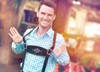 Man posing in traditional Bavarian Lederhosen