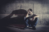 wasted young man on street with shadow feeling miserable poster