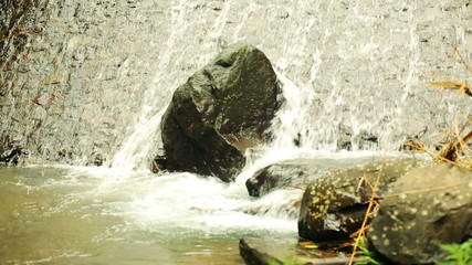 Water in river flowing by stones