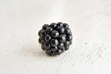 Blackberry on White Wooden Background