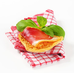 Slice of prosciutto on crispy bread