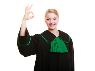 Law. Woman lawyer in polish gown showing ok okay.