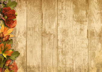 Vintage wooden background with autumn decorations
