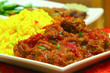traditional indian curry in dish with pilau rice