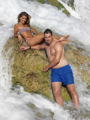 Young couple bathing