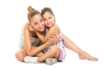 Young mother and daugther hugging and smiling