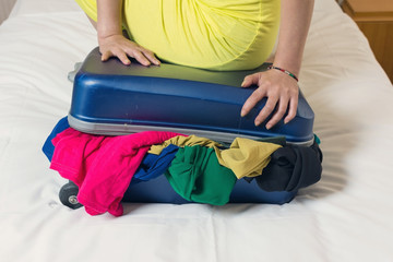 close the overfilled suitcase