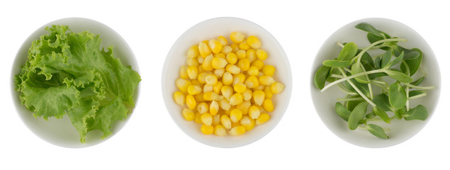 Lettuce, corn and sunflower sprout in white bowl