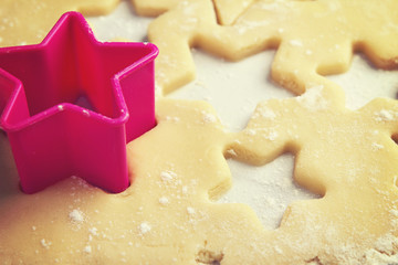 Close up of pink cookie cutter in dough