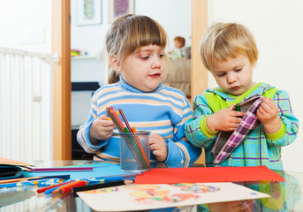 serious children playing with pencils