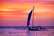 Sailing boat in the beautiful sunset.