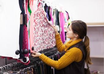 woman choosing dress at  store