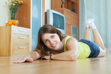 Woman lying on hardwood floor