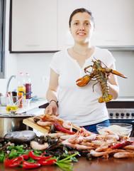 Woman cooks seafood