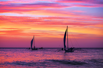 Two sailing boat in the beautiful sunset
