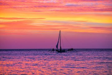 Sailing boat in the beautiful sunset