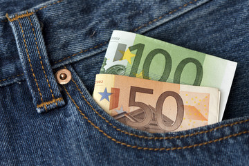 100 and 50 euro banknotes in a pocket
