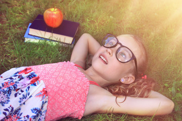 Summer relaxing on the grass with your favorite book