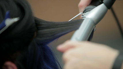 Hairdresser makes perm curling