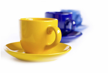Multicolored teacups and sausers