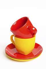 Multicolored teacups with saucers