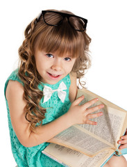 preschooler girl with book
