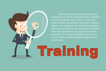 Businessman with Magnifying glass with words Training