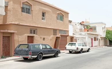 Street view with parked cars, Rahima town, Saudi Arabia