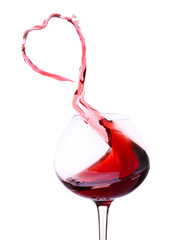 Wineglass with splashing red wine, isolated on white
