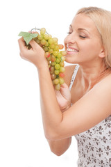 young girl holding fresh grapes.