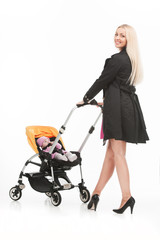young beautiful mum with baby in stroller.