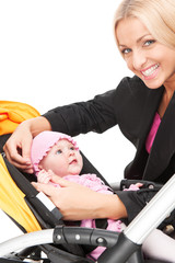 young beautiful mum with baby in stroller