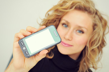 Businesswoman showing mobile phone