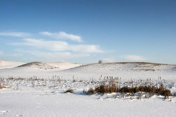 Snowy hills in the winter view field
