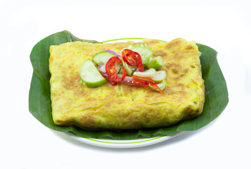 Vietnamese stuffed crispy omelet on banana leaf