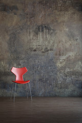 Red chair in old environment